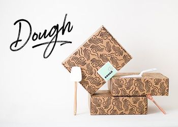 Dough logo overlaid Doughh product boxes stacked.