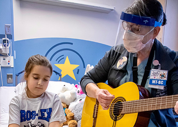 Jody Stark conducts music therapy session at the Children's Hospital of Michigan.