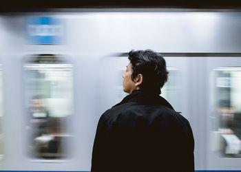 Commuter waits for train.