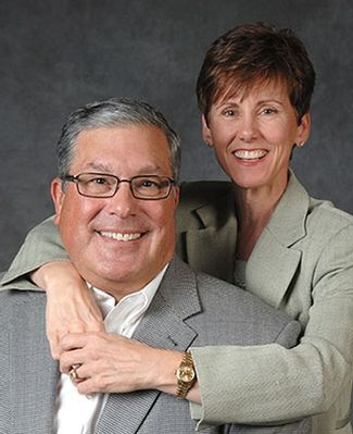 A formal portrait of Bob and Julie Skandalaris
