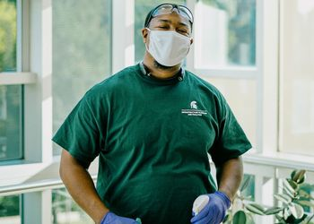 IPF worker disinfects surfaces
