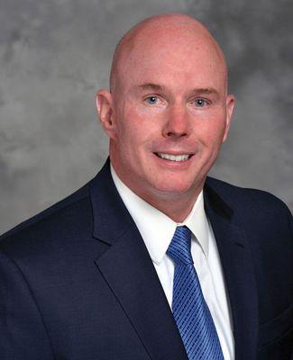 Formal portrait of Tom Mee, president of McLaren Greater Lansing
