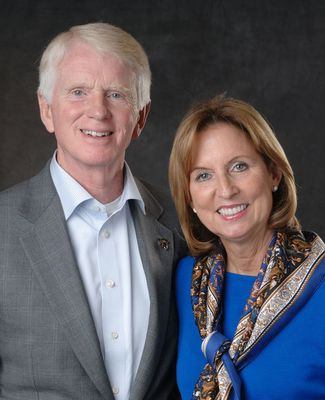 Craig and Vicki Brown, in formalwear, pose for a portrait