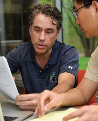 John Dorgan talks with a research assistant