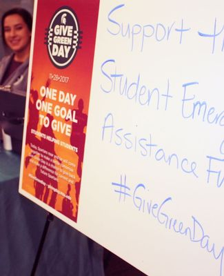 signange at a Give Green Day event