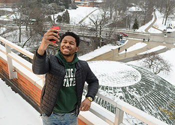 Tim Herd snaps a bird's eye selfie from Erickson Hall