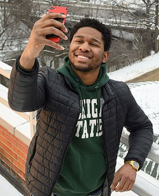 Tim Herd snaps a bird's eye selfie from Erickson Hall