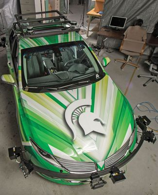 A wrapped Lincoln MKS sedan outfitted with sensors and cameras