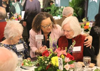 MSU staff members converse over lunch