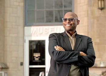 Julian Chambliss stands outside the entrance to the MSU Museum