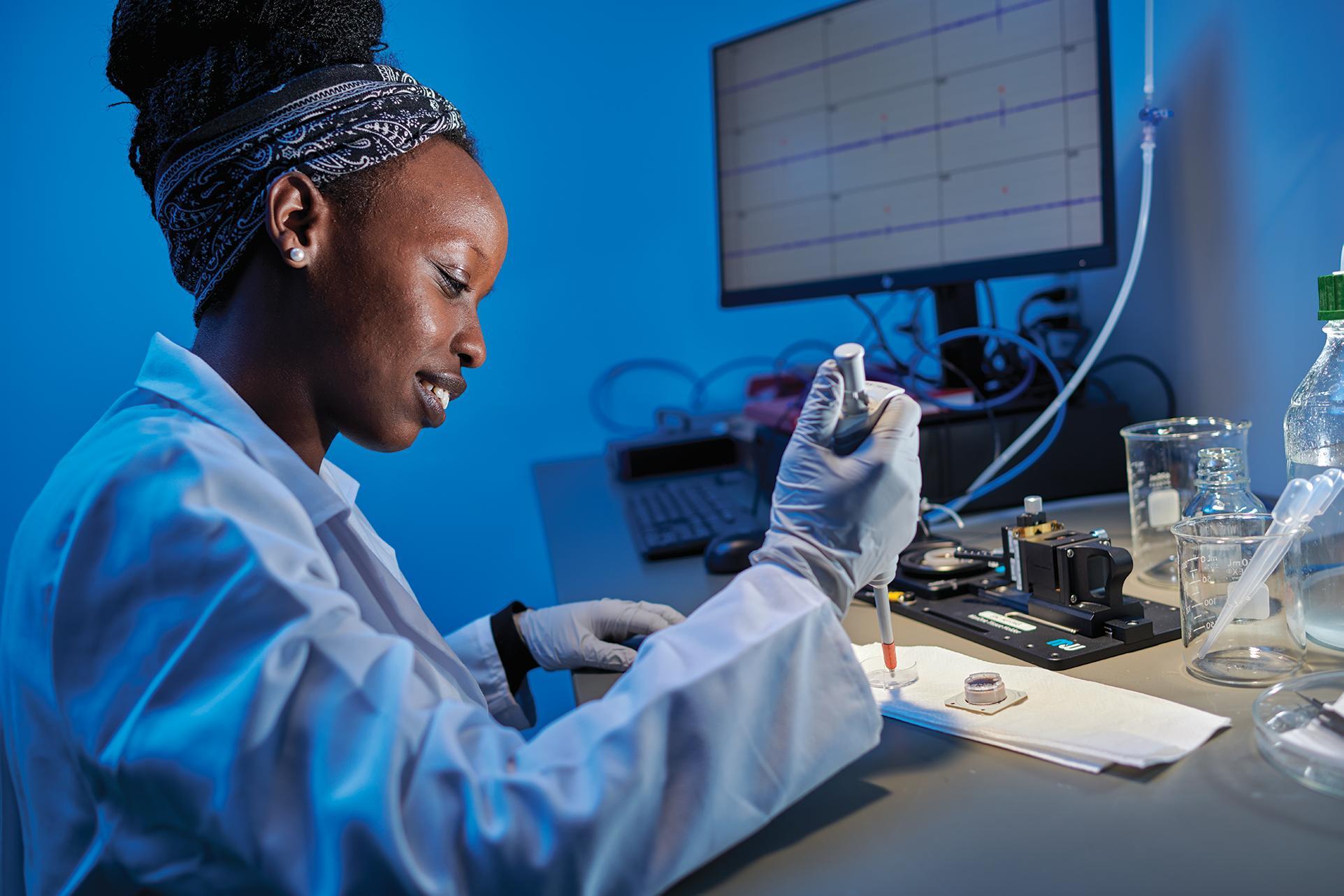 scientist prepares microelectrode array