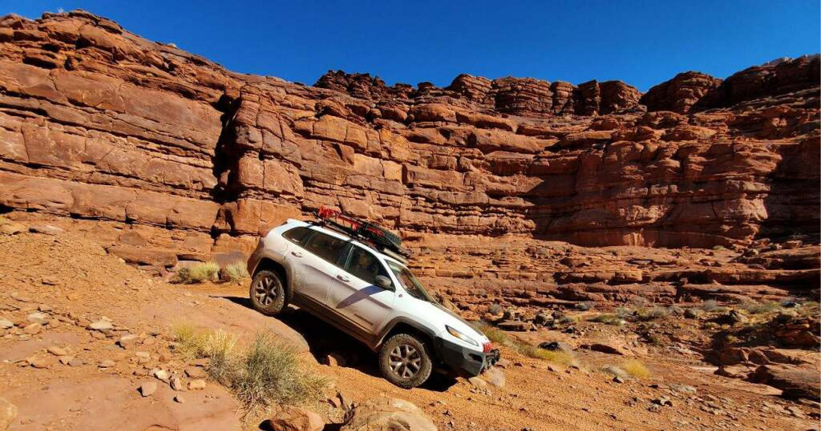 jeep moves through offroad trail