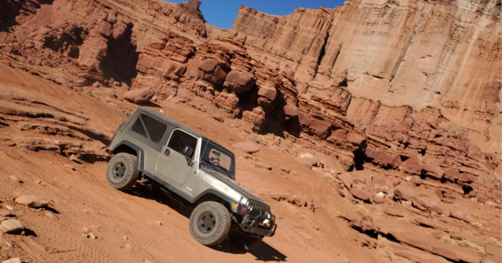 jeep trudges through offroad trail