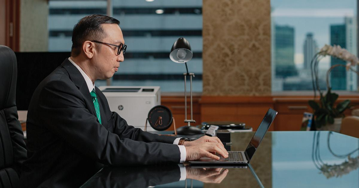 Iwan Syahril typing on computer