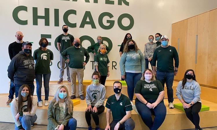group of Chicago Spartans posing in masks after their service project