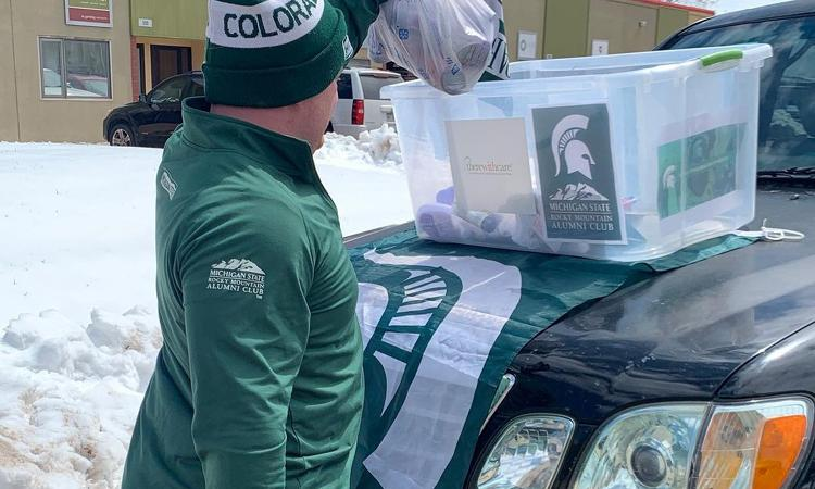 Colorado Spartan collecting items for a drive
