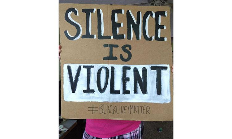 a black lives matter poster that reads: silence is violent