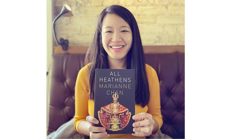 """Marianne Chan holding """"All Heathens"""""""