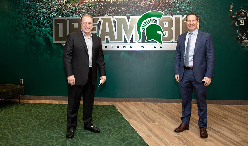 tom izzo and mat ishbia stand socially distanced in the MSU athletics offices