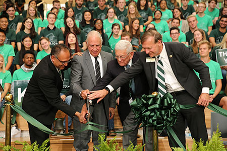 dean gupta, edward minskoff, eli broad, and president stanley at a ribbon cutting