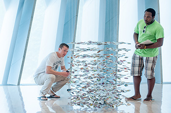 Students Viewing Broad Art Sculpture