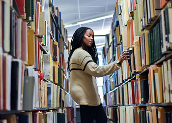 College of Arts and Letters student in the library