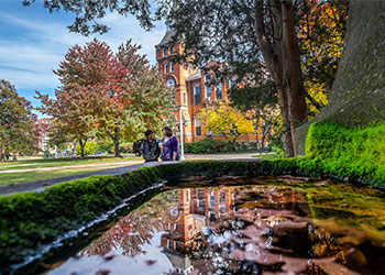 Photo of Linton Hall with two students walking in the background.