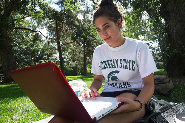 A MSU student working on her computer