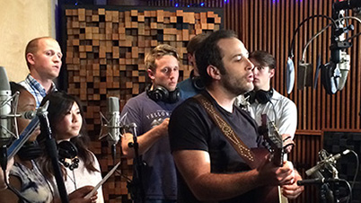 Photo of Joshua Davis recording MSU Shadows with MSU College of Music students