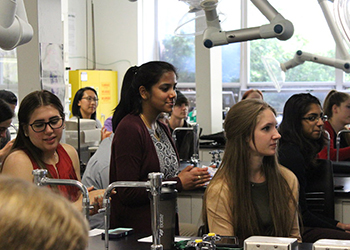 Young women in a science class