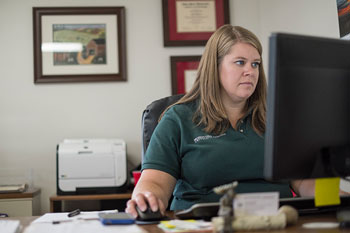 MSU Extension officer working at desk
