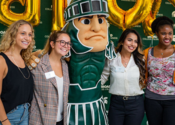 Business students with sparty