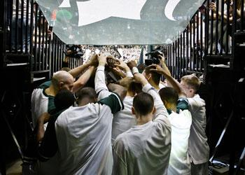 Spartan Basketball team huddle