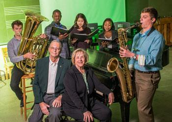 Saxophonist Travis Sinclair and other College of Music students surround Jack and Dottie Withrow (center, bench), who recently created an endowment to help music students develop business skills.
