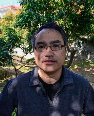 Click to enlarge                Zhiyong Xi, MSU assistant professor of microbiology and molecular genetics