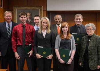 The fall 2013 Board of Trustees' award winners pose with MSU President Lou Anna K. Simon, Chairperson Joel Ferguson and Vice Chairperson Brian Breslin Dec. 13.