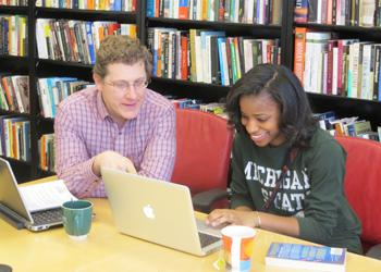 John Waller, director of Social Science Scholars, a brand- new undergraduate program, works with student Jolisa Brooks