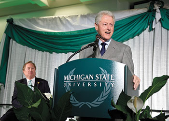Bill Clinton speaks to students and dignitaries