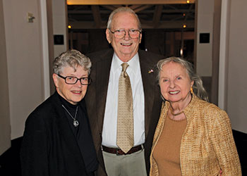 MSU President Lou Anna K. Simon pictured with Fred Addy and Marilyn Addy, dressed up for a special event.