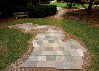 A granite patio in the shape of the state of Michigan.