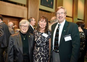 Daniel and Debra Edson pose with President Simon at a formal event