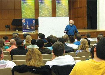 John Kratus presents to an auditorium filled with music education students