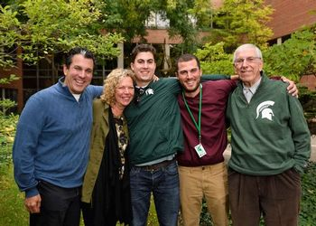 The Riguardi family, dressed for a football game, pose together on campus