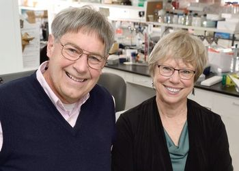 Dan and Karen Friderici pose in a lab