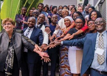 Stakeholders for the MasterCard partnership pose at an event in Nigeria in May, 2017