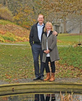Joe and Laurie Thorp pose near the Beal Garden pond in the fall