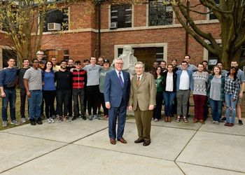 James Billman poses with College of Music dean Forger outside the music building with students.