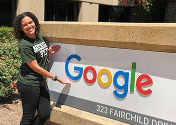 mariah smith poses in front of the sign at Google headquarters